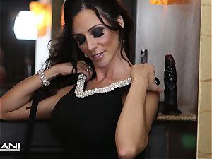 Ariella Ferrara stuffs a fat black dildo in her muff