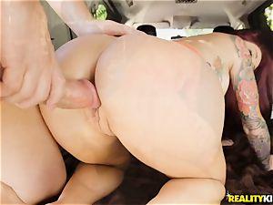 Monique Alexander blows a gigantic rod in the car