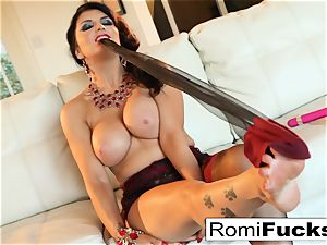 Smoking hotty Romi Rain takes care of her humid twat
