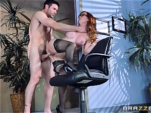 Dani Jensen toying with man rod in the office