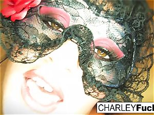 Charley wears some sexy underwear and stocking