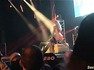 huge-boobed cougar lapdance on stage