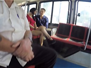 Karmen Bella pounds her fellow on a crowded bus