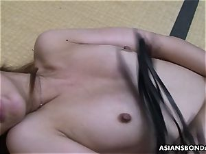 japanese sadomasochist playthings her unshaved vagina while being lashed
