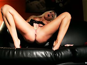 buxom Britney strokes on the sofa